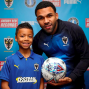 Matchday mascot with Andy Barcham and the match ball