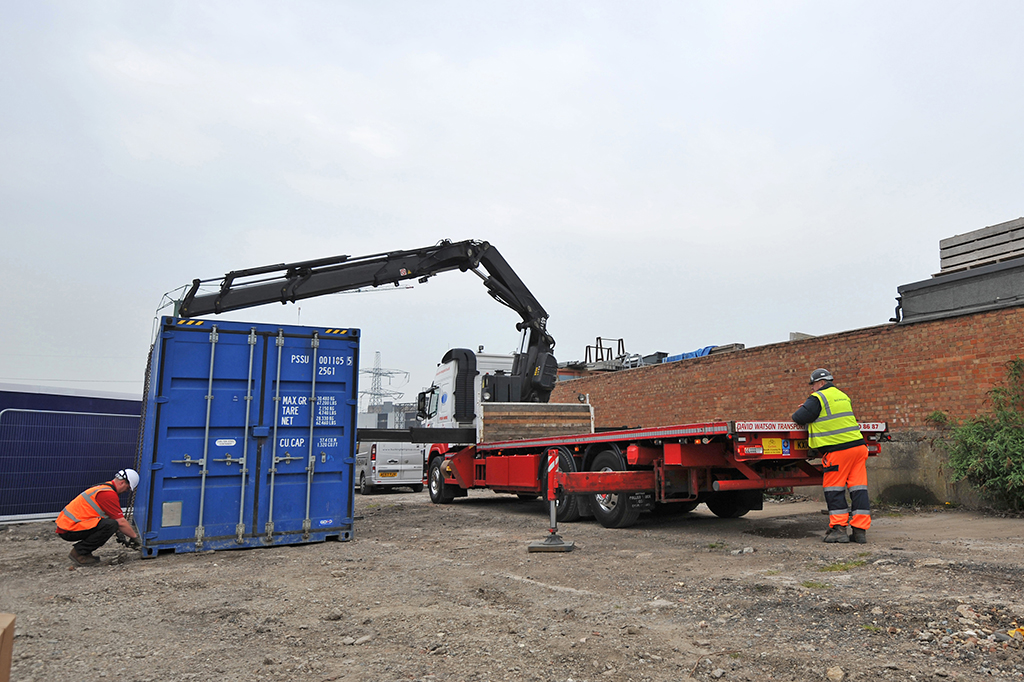 A storage container is delivered as part of site set-up