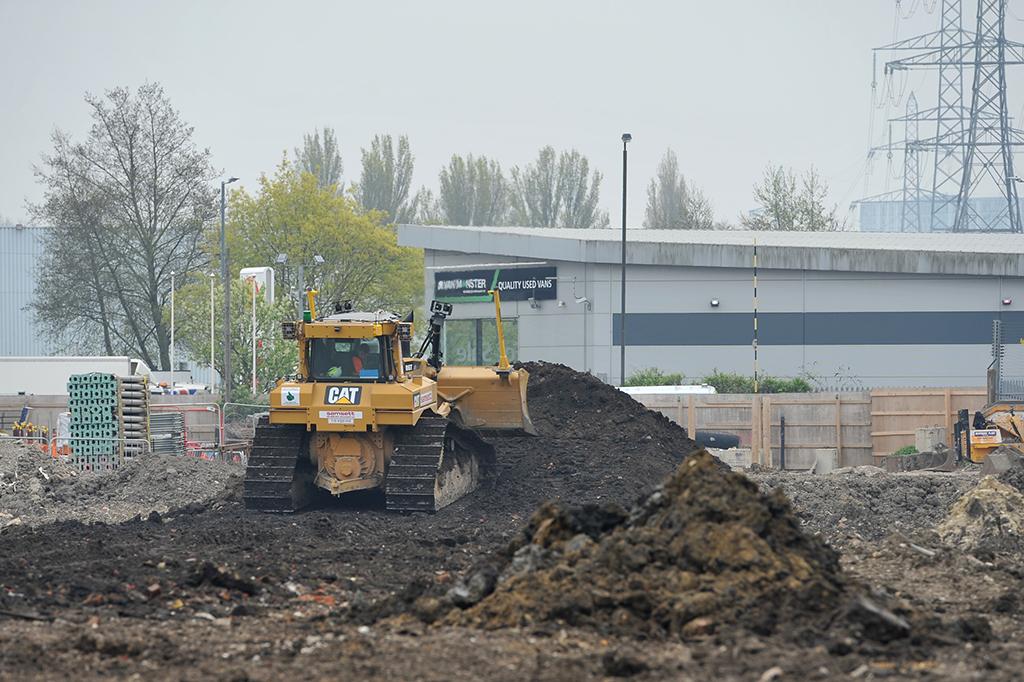 A bulldozer moves earth