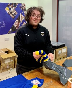 George Jones helping in the club shop